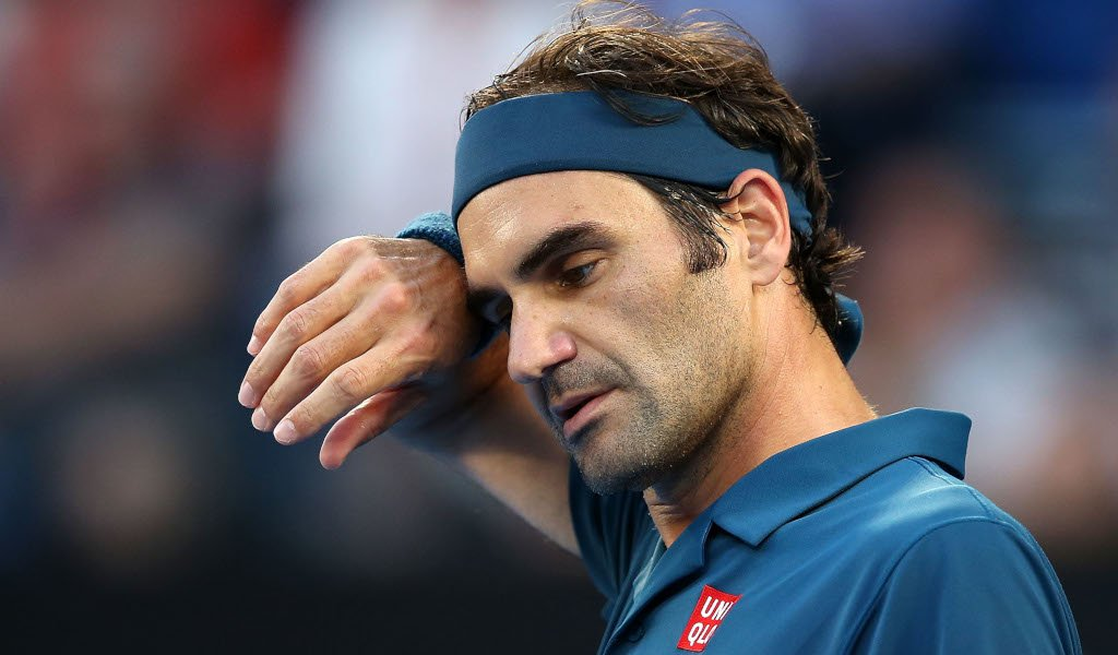 Roger Federer wiping his face - FirstSportz