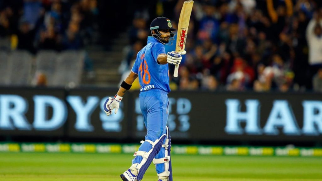 Virat Kohli celebrates his half century