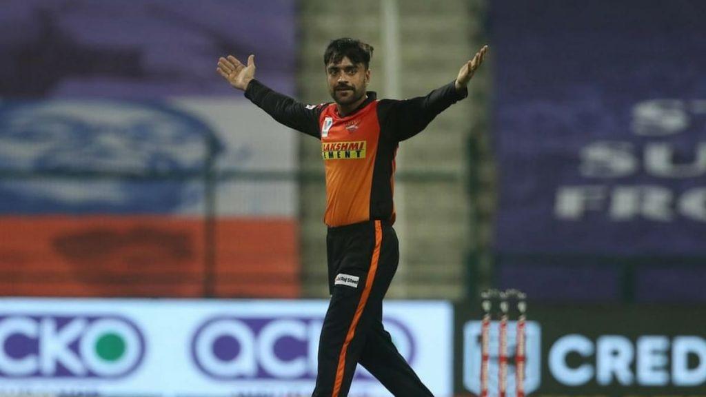 Rashid Khan celebrates a wicket against DC