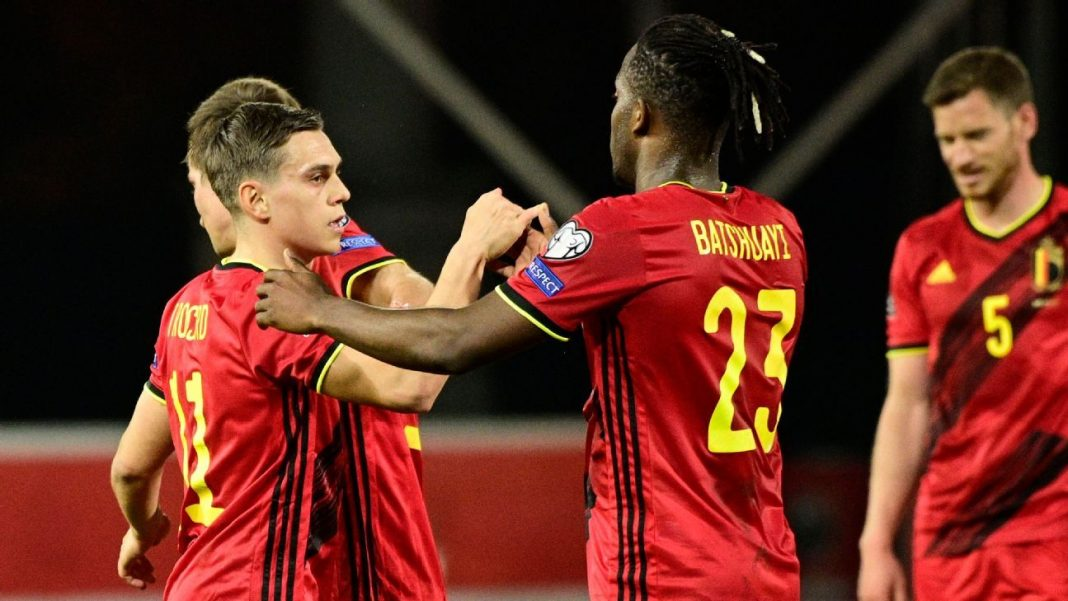 Belgium players celebrate their 8-0 win over Belarus