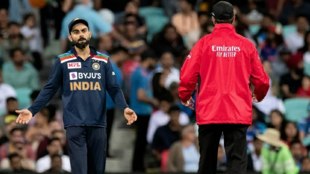 Virat Kohli in a discussion with umpire