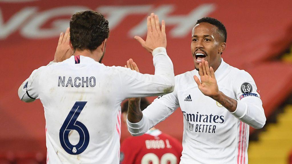 Eder Militao and Nacho celebrate their win - FirstSportz