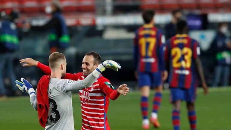 Granada player celebrating their win - FirstSportz
