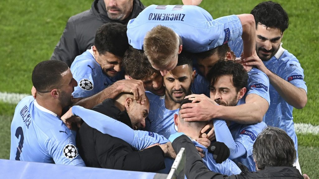 Manchester City players celebrating with Guardiola - FirstSportz