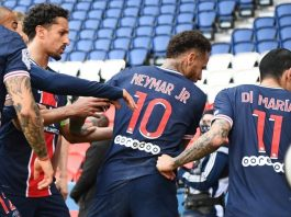 Paris Saint Germain players trying to calm Neymar down and carry him into the dressing room after the match