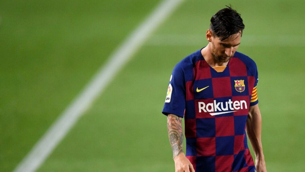 A dejected Lionel Messi walks of a Barcelona defeat