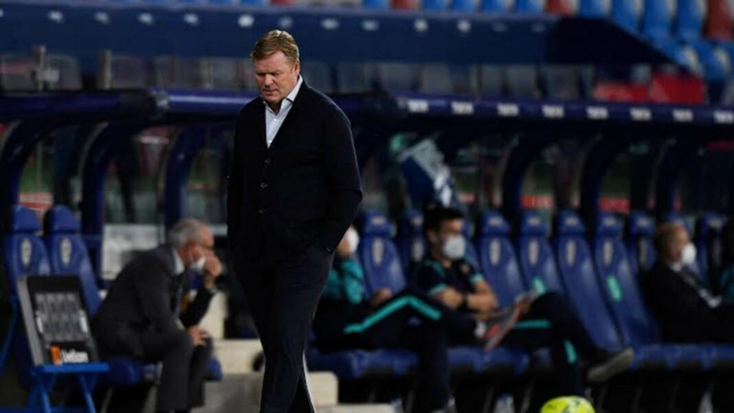 A dejected Ronald Koeman walks off the pitch