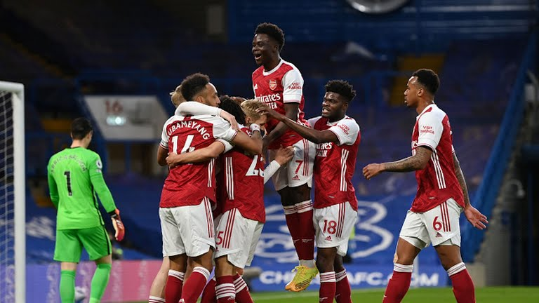 Arsenal players celebrate their first goal - FirstSportz