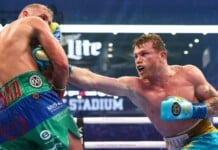 A powerful body shot from Canelo Alvarez (R), on Billy Joe Saunders