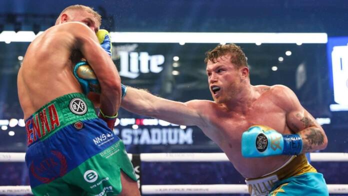 A powerful body shot from Canelo Alvarez (R), on Billy Joe Saunders