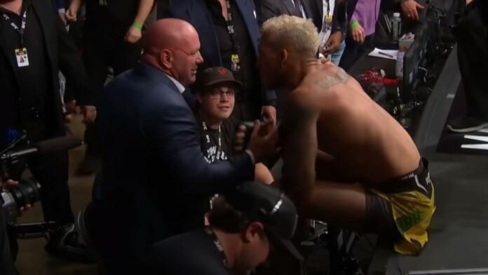 Charles Oliveira talking to Dana White after UFC 262