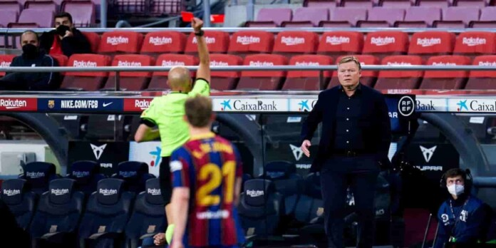 Ronald Koeman being shown a direct red card by the referee