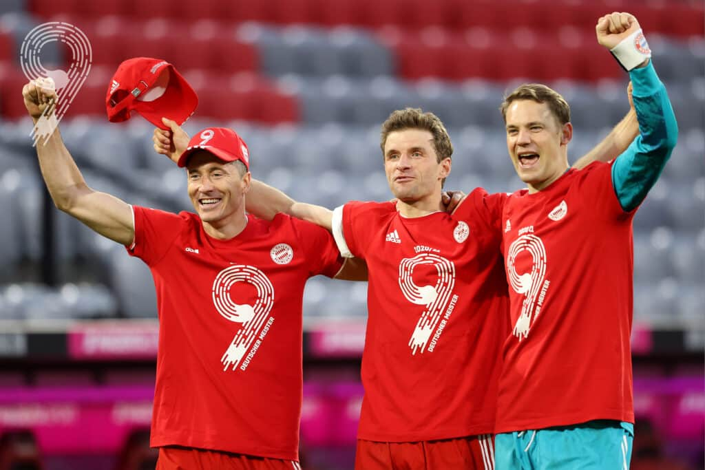 Lewandowski Muller and Neuer celebrate the title win - FirstSportz