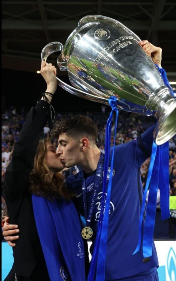 Havertz and Sophia share an emotional embrace while holding the trophy.