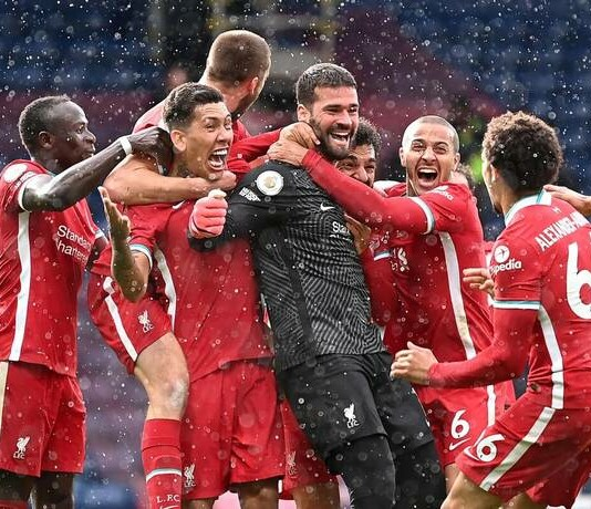 Liverpool celebrate Alisson's late winner