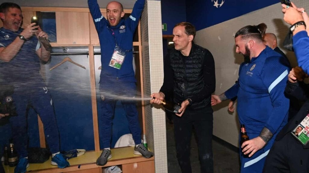 Tuchel celebrates with his support staff and players in dressing room