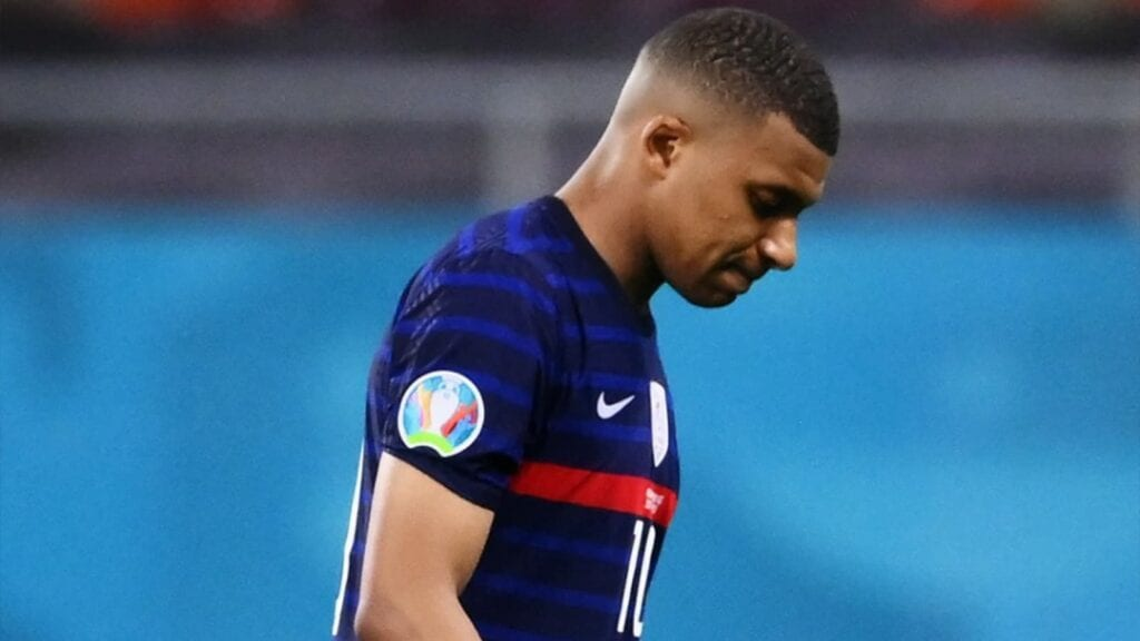 A disappointed Kylian Mbappe after his penalty miss