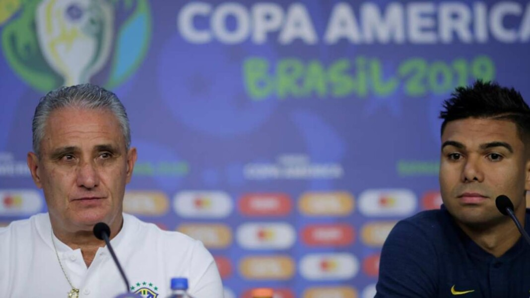 Brazil captain and coach in a press conference