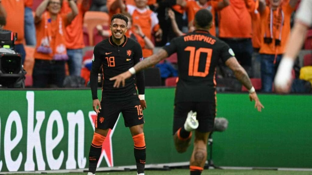 Depay celebrates after scoring his first goal