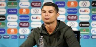 Cristiano Ronaldo removes Coca-Cola bottles at the Portugal press conference