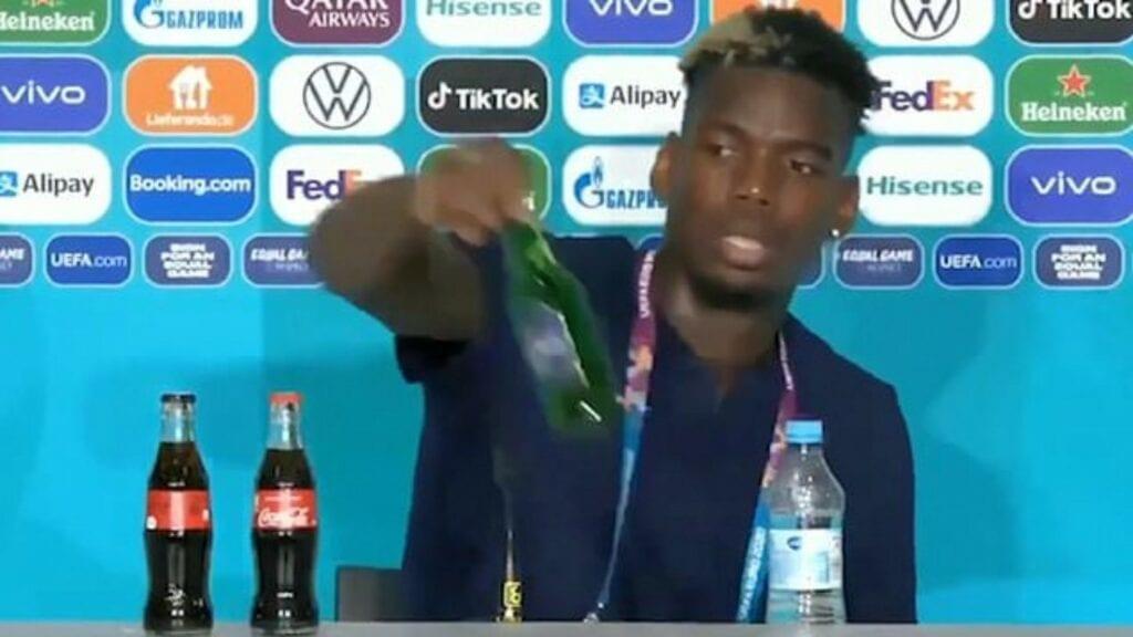 Paul Pogba removes a Heineken bottle