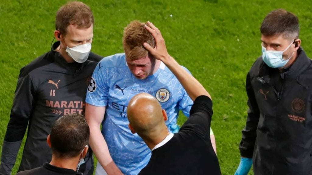 Pep Guardiola consoles De Bruyne as he walked off injured in the Champions League final