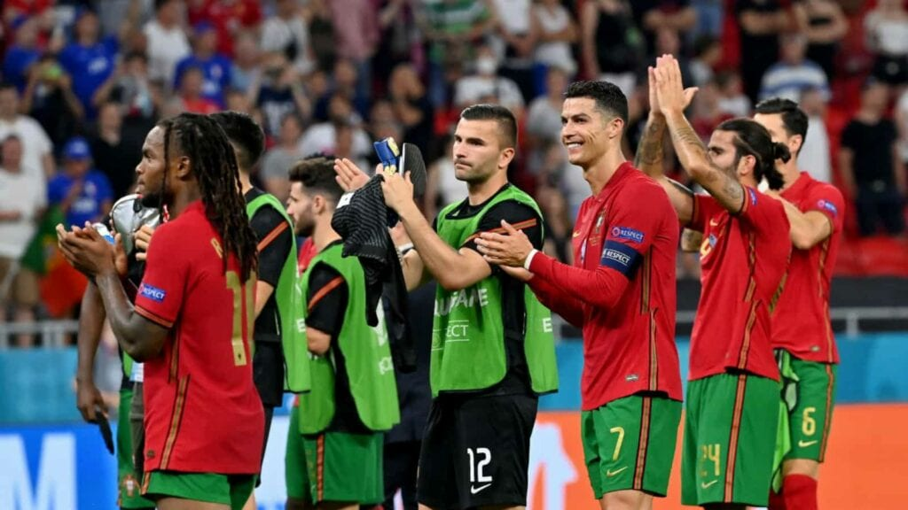 Portugal players after securing the required point against France - FirstSportz