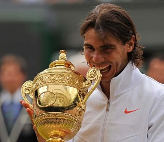 Rafael Nadal with his 2010 Wimbledon Trophy
