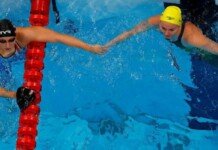 Ariarne Titmus and Katie Ledecky wait after the 200m freestyle race