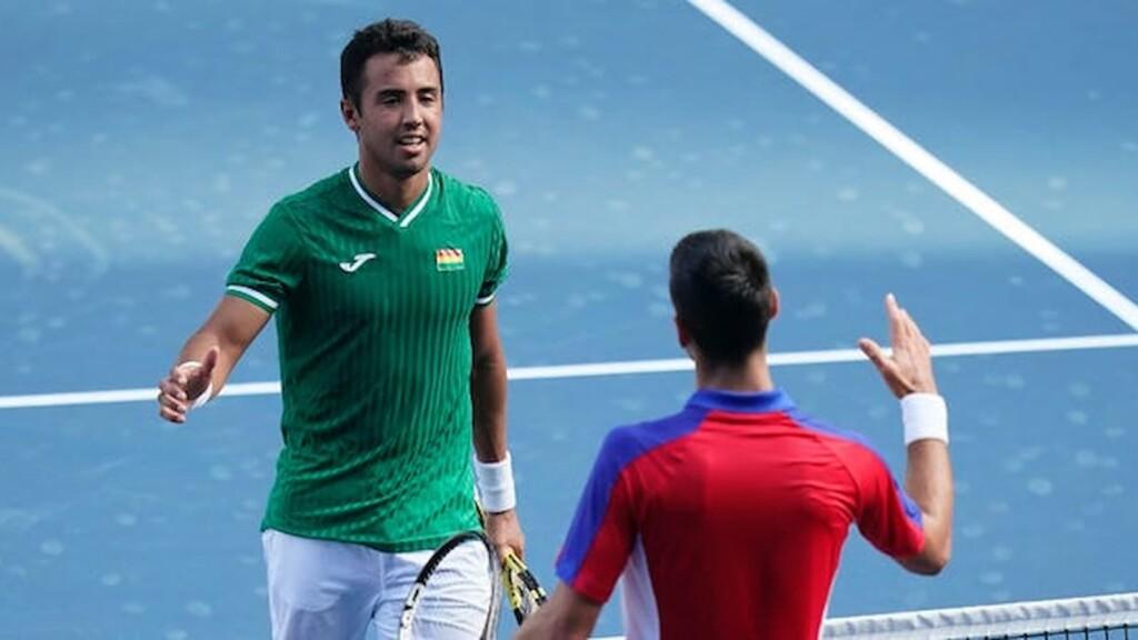 Hugo Dellien and Novak Djokovic