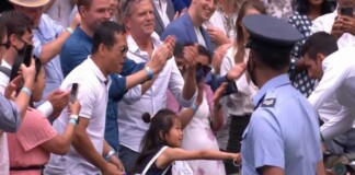 Novak Djokovic gives his racquet to a young fan