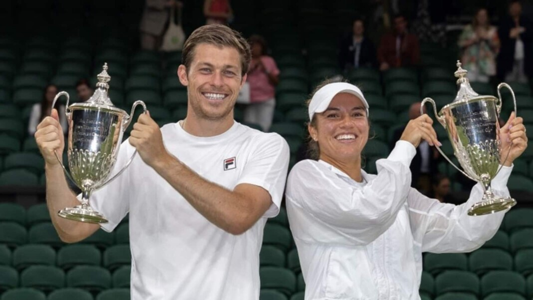 Neal Skupski and Desirae Krawczyk with their Wimbledon 2021 Mixed Doubles Trophies