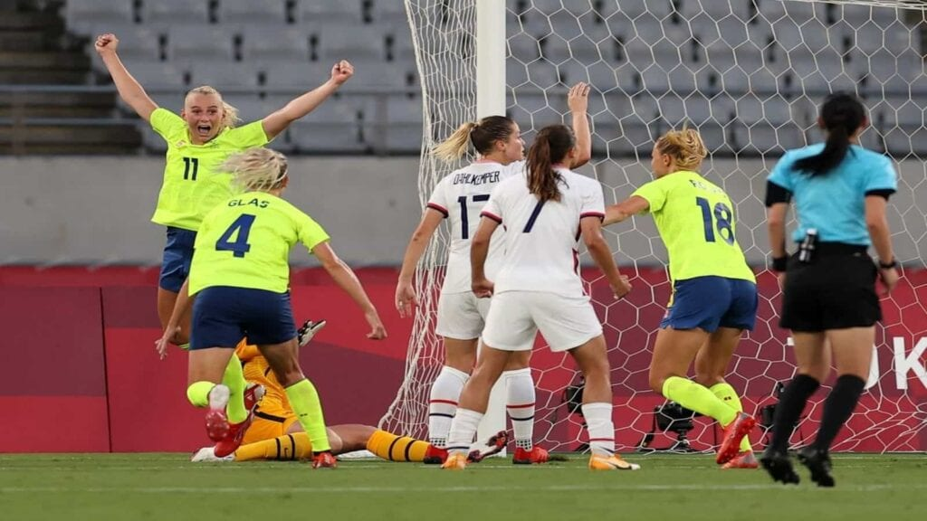 The Sweden players celebrate their goal against the US in the first match of the Olympics