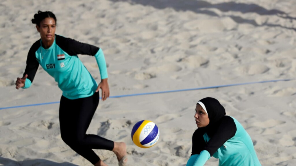 Egypt's Doaa Elghobashy, right, sets up for teammate Nada Meawad against Canada in Rio Games 2016